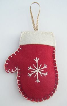 Made from felt with cream hand embroidery snowflake detail and blanket stitched edges, lightly stuffed with polyester filling and complete with metallic ribbon. Available in green or maroon, plea Felt Christmas Decorations, Felt Christmas Ornaments, Christmas Sewing, Handmade Christmas, Felt Crafts, Holiday Crafts, Red Mittens, Ribbon On Christmas Tree, Handmade Felt