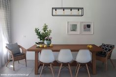 A bright and fresh dining room with a wooden custom made table, designed by #eNJOY architects.