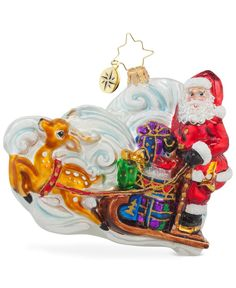 This Guide the Way ornament from Christopher Radko features Santa standing on his reindeer-led sleigh filled with gifts for all! | Glass | Wipe clean | Imported | Includes collectible signature tag ch