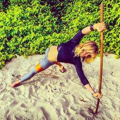 Side plank for strengthening the shoulders and core with a unique broomstick variation (advanced). When you keep exercise interesting, it doesn't seem like exercise at all.. It's a fun challenge. Pic by @wade.adams #worldsurfers #sideplank #surfing #surffitness #surftraining #strong #shoulders #core #abs #calisthenics #bodyweight #physicalculture #move #movement #active #broomsticktraining #fitness #surfleggings @saltgypsy