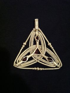 Silver wire wrapped pendant w/ garnets by MadeGalleryChicago, $450.00