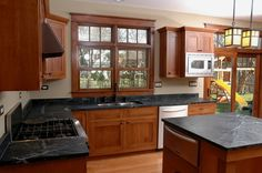 I suspect this is what my kitchen would look like with wood cabinets.  Needs a backsplash and some color.