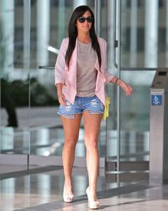 I don't always like Tulisa's style, but I thought this was a very nice summery and girly outfit from her. Love the cute denim shorts and pink cardi. I also like how she teamed this casual outfit with heels to give it some class. She looks good with long dark hair too.