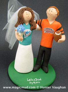 Miami Dolphins Football Wedding Cake Topper,Football Wedding Anniversary Gift/Cake Topper, NFL Football Wedding CakeTopper, NCAA Caketopper    This photographed listing is but an example of what we will create for you....simply email or call us toll free with your own info and pictures of yourselves, and we will sculpt for you a one of a kind NFL or College Football Wedding Cake Topper figurine!  1 800 231 9814    $235 #magicmud 1 800 231 9814 www.magicmud.com