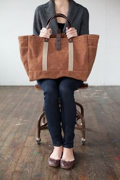 Chris Hughes from Sattle Creeks' Beep Beep started his own bag company based out of Omaha. All of his bags are handmade with vintage machinery, American-made waxed canvas & leather. I want this bag.