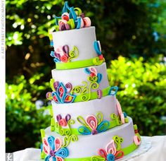Light purple fondant and fuchsia, blue and purple art-deco flowers decorated the four-tiered cake