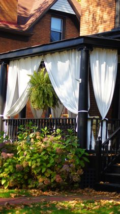 """I think the dark paint colors really clash with the white """"curtains. I'd change them to a burlap or butterscotch color or take them down all together. Architectural Landscape Design"""