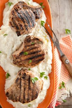 Stuffed Pork Chops with Grits! They are stuffed with sausage! Try your fave to see what makes this recipe POP for you! The addition of the creamy grits gets an A++!