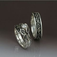 There are clusters of small leaves that wrap this band, with formal edges to create a natural elegance. There is a light oxidation to enhance the