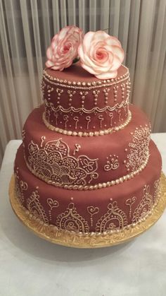 Henna inspired cake completely piped by hand with royal icing and then hand painted with gold luster dust.