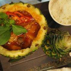 Red thai curry served in a coconut at Mango Tree restaurant in Harrods, London