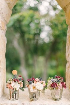 Make your own mercury glass votives for your wedding day decor! It's easy with our DIY tips! | http://www.weddingpartyapp.com/blog/2014/10/20/diy-mercury-glass-centerpiece-vases/