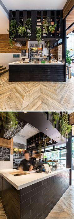 Hexagon Tiles Transition Into Wood Flooring Inside This Cafe In - designer mobel aus holz joyau bilder