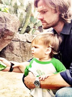 "Hahaha, they both look so intent. Jared's all like, ""Now Tom, feeding turtles is very serious business, not to be taken lightly."" And the kid's all like, ""Yes Father, I understand."""