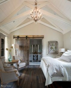 Barn door separating room and bath... great for our room! Rustic farmhouse style master bedroom ideas (10)