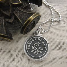 Forget Me Not Antique Wax Seal Necklace.