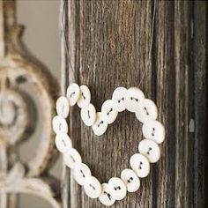 Old wood with darling heart buttons