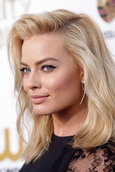 Margot Robbie at the Critics' Choice Awards 2014 - The big day should be all about a natural glow; tousled, side-swept waves like Margot's and pristine eyeline flicks are the perfect way to show off your illuminated skin.