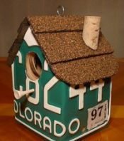 Bird house made from old license plates... May have to figure out how to do this one!