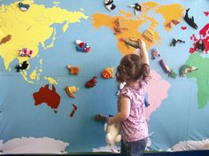 Map with little felt animals and landmarks like the great wall of china and the pyramids that you can Velcro to the map too. So AWESOME!