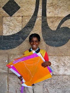 boy at a kite festival in india