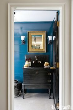 In a New Jersey cottage designed by Michael Aiduss, Farrow & Ball's Hague Blue is a background for the powder room's black washstand, adapted from an antique wedding chest and stand. Cottage Design, Cottage Style, House Design, Hague Blue, Cape Cod Style House, Black Cabinets, Blue Walls, Beautiful Bathrooms, Decoration