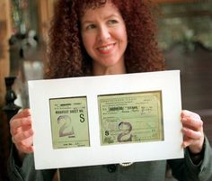 Cheryl Gorsuch holds what is believed to be the last remaining complete Titanic ticket that was used by 19-year old survivor Anna Sofia Sjoblom.  The document, possibly the only complete one of its kind for the Titanic, is an immigrant inspection card that was issued to Sjoblom of Finland, who pinned it to the inside of her jacket. (AP Photo/The Seattle Times, Steve Ringman)