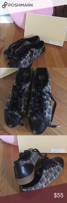 Authentic Michael Kors City Sneakers 8.5 Authentic Monogram Jacquard Michael Kors City Sneakers 8.5 . Used only once perfect like new condition in Original Box . Michael Kors Shoes Sneakers