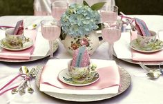 """Pink Tea Party: Tea pot filled with fresh hydrangeas.  Utensils with thin ribbon with the tails long and trailing. What else do you serve at a """"pink"""" tea party other than pink lemonade!?  """"Tea bag"""" favors filled with cookies  that double as place cards as they are displayed inside the tea cups."""