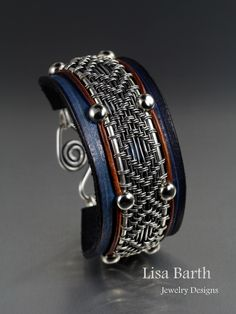 A new way of doing the leather with the wire work.  I hand wove the wire work and hand made the leather bracelet part.  I am working on a better clasp for it.  :)