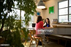 Stock Photo : cheerful friends talking  at  cafe