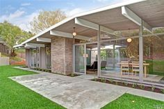period appropriate patio with simple landscaping transition +Eichler♡