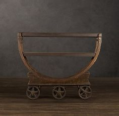 A wood-and-iron cart that transported spools of wallpaper in an early 20th-century American factory was the inspiration for our rolling bar.