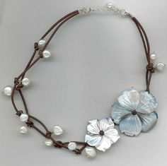 Google Image Result for http://www.lotusdirect.co.uk/images/products/FlowerNecklace.JPG