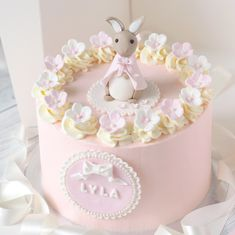 A cute Flopsy Bunny birthday cake; yummy chocolate sponge, filled & covered with pink vanilla buttercream, topped with a pretty little sugar Flopsy bunny & decorated with flowers 🐰🌸🎂💕 Bunny Birthday Cake, 1st Birthday Cake For Girls, First Birthday Cakes, Baby Birthday, Baby Girl Christening Cake, Baby Girl Cakes, Pink Vanilla, Peter Rabbit Cake, Chocolate Sponge