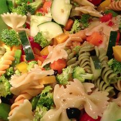 This tastes soo amazingly good :) Vegetable Pasta Salad ! Made with:  bow tie noodles and spiral noodles, cucumbers, carrots, sharp cheddar, black olives, yellow, orange and red peppers, tomatoes, sugar snap peas, broccoli and Italian salad dressing ! #food #recipe #vegetarian #organic #yummy .. Just practicing my housewife skills ;) you know