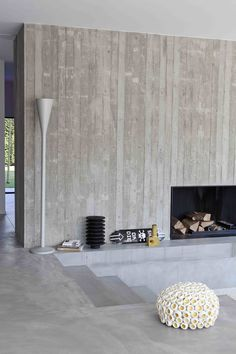 vertical board-formed concrete at minimalist fireplace // Hart Concrete Design: Concrete Fireplace, Concrete Houses, Concrete Wood, Modern Fireplace, Concrete Design, Fireplace Wall, Living Room With Fireplace, Fireplace Surrounds, Fireplace Design