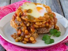 A fabulous brunch dish that's quick and easy to prepare. Who doesn't love a lazy weekend brunch? With this recipe there is only one pot to wash up, making sure that easy Sunday days are exactly that. Beans On Toast, Brunch Dishes, Baked Eggs, Rhodes, Spicy, Breakfast, Board, Recipes, Hair