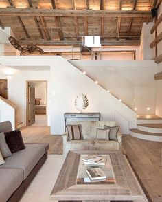 rustic modern living room. wood beam ceiling.