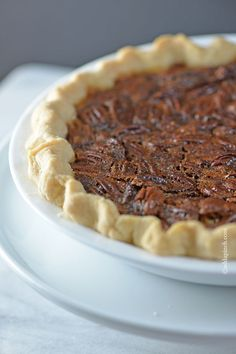 This Pecan Pie Recipe is a classic in my husband's family. For every family gathering, you better believe there will be pecan pie sitting front and center on the dessert table. Every. single. time. // addapinch.com