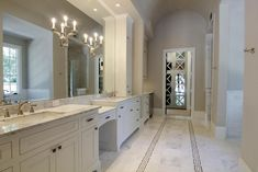 The Master Bathroom has a  barrel-vaulted ceiling above the mirrored wall, abundant cabinets and drawers, and a private water closet. The classic inlay in the marble flooring extends from the Master Bedroom to the Master Closet seen in the back.