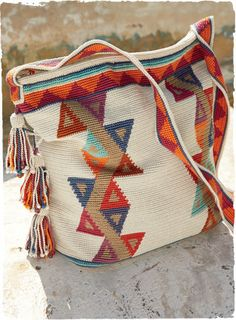 The intricately handcrocheted pima tote is patterned in a mosaic of triangles and zigzags. Detailed with shoulder strap, zip top and beaded ...