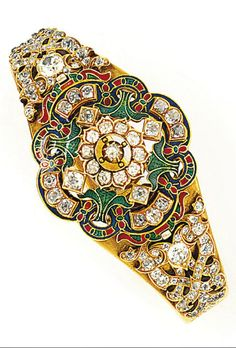 A late 19th century Holbeinesque diamond and enamel bangle. The front of tiered openwork design, set with an old brilliant-cut diamond cluster centre within a polychrome enamel and diamond foliate surround, the shoulders set with old brilliant-cut diamonds to a foliate engraved hinged bangle, circa 1870, inner diameter 5.7 cm, front detachable.