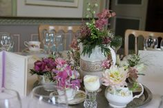 A cute little coffee service with fresh flowers