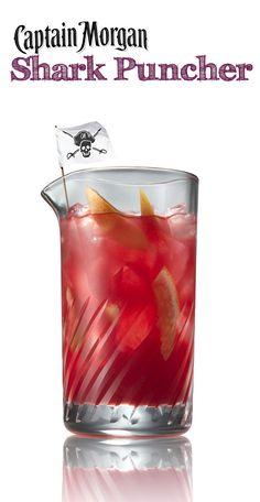 Shark Puncher cocktail - coconut rum, grapefruit juice, cranberry juice, and orange juice! So yummy!