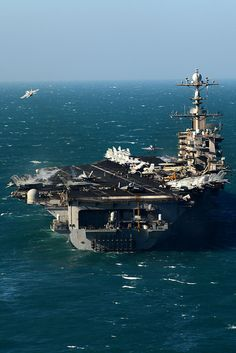 USS John C. Stennis launches aircraft at sea. by Official U.S. Navy