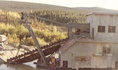 This dredge moved up Clear Creek the year after we left and it does not miss much.  Floating on a self maid pond being pulled back and forth across the valley with huge cables.  This unit had several sluice boxes inside and a hydraulic boulder pusher, to get ride of large rocks several hundred pounds in weight.