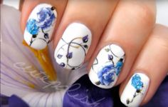 Nail art looks so beautiful but so incredibly complicated to do! Well, this simple design only requires on simple thing: temporary tattoos.