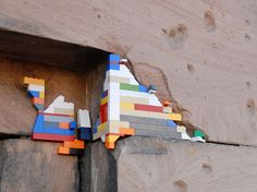 Legos applied to cracks in a building.  Cool!