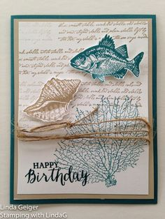 "Image of a card, stamped with Stampin' Up! Stamp Set ""By the Tide."" Island indigo on white card stock."